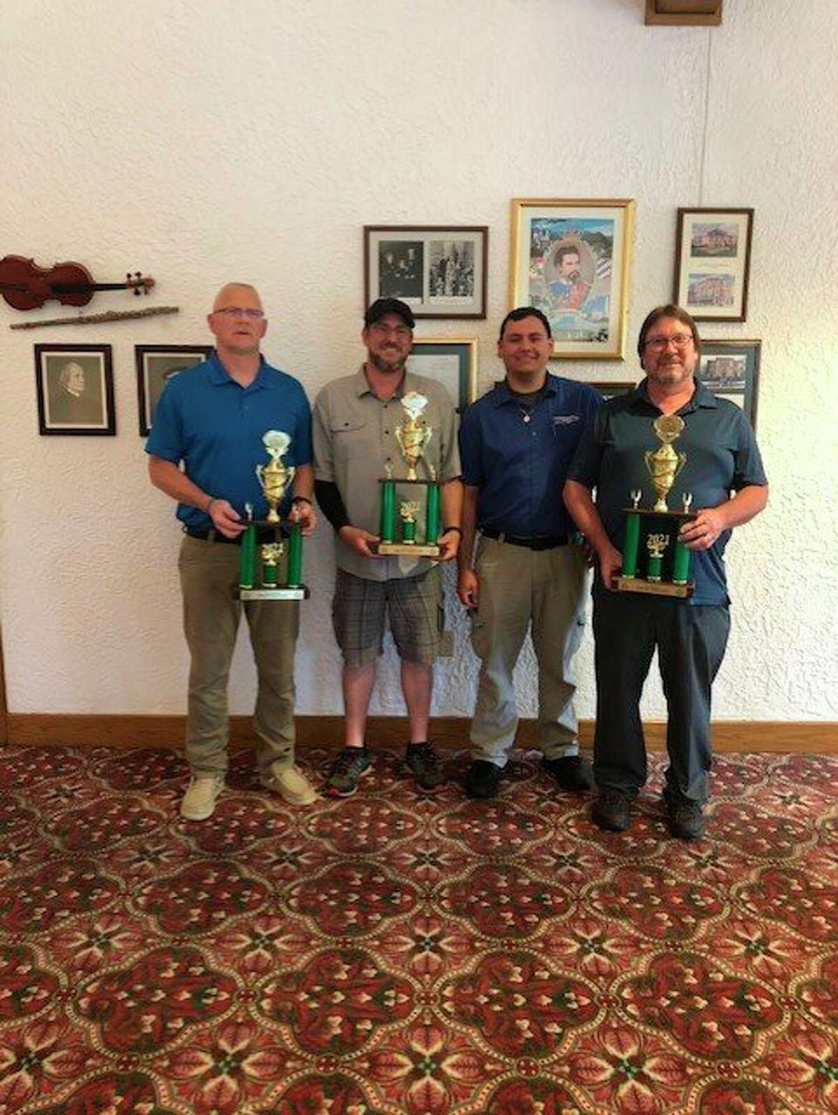 Douglas Ross, Timm Forth, and Wayne Kinney hold the trophies they received from placing in this year's Michigan Small Bus Roadeo in Frankenmuth. In the individual competition, Kinney finished fourth, Forth finished fifth, and Ross finished sixth. (Thumb Area Transit/Courtesy Photo)
