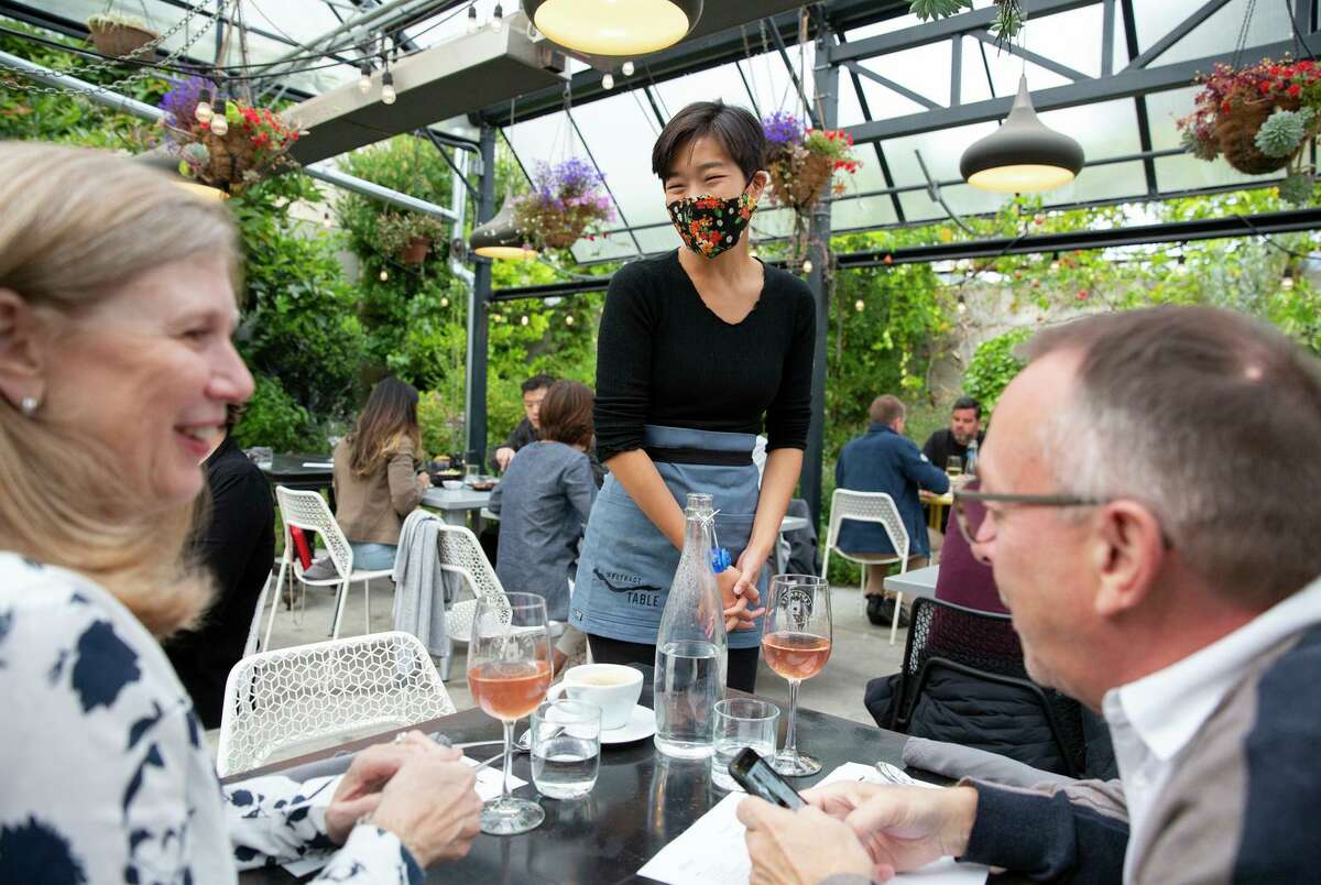 Jessica Shen talks with guests Kathy Dumbleton and John Flanagan while they dine at Abstract Table in Berkeley.