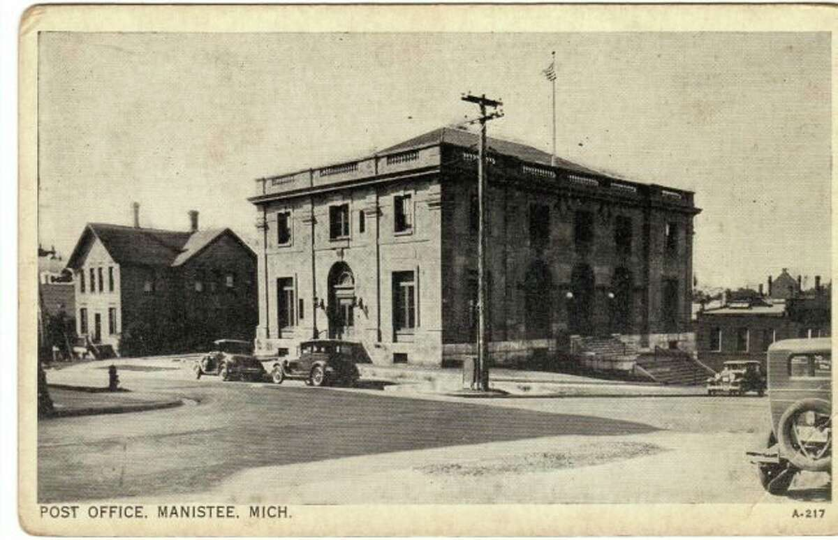 The Manistee Post Office building located on Maple Street that is the current home of the Manistee City Hall is shown in this photograph from the 1920s. (Manistee County Historical Museum photo)