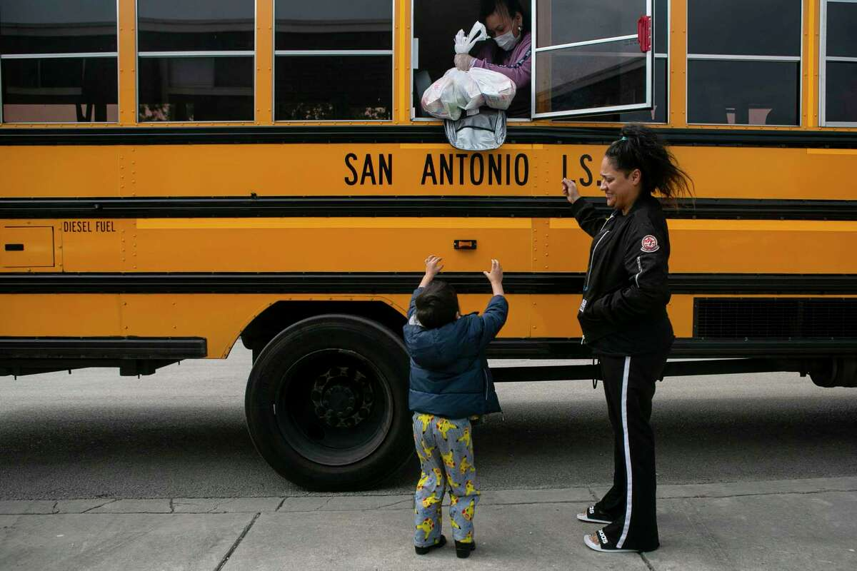 A grandmother and grandson receive a bagged lunch from SAISD in April 2020. Let's make recent school lunch changes permanent.