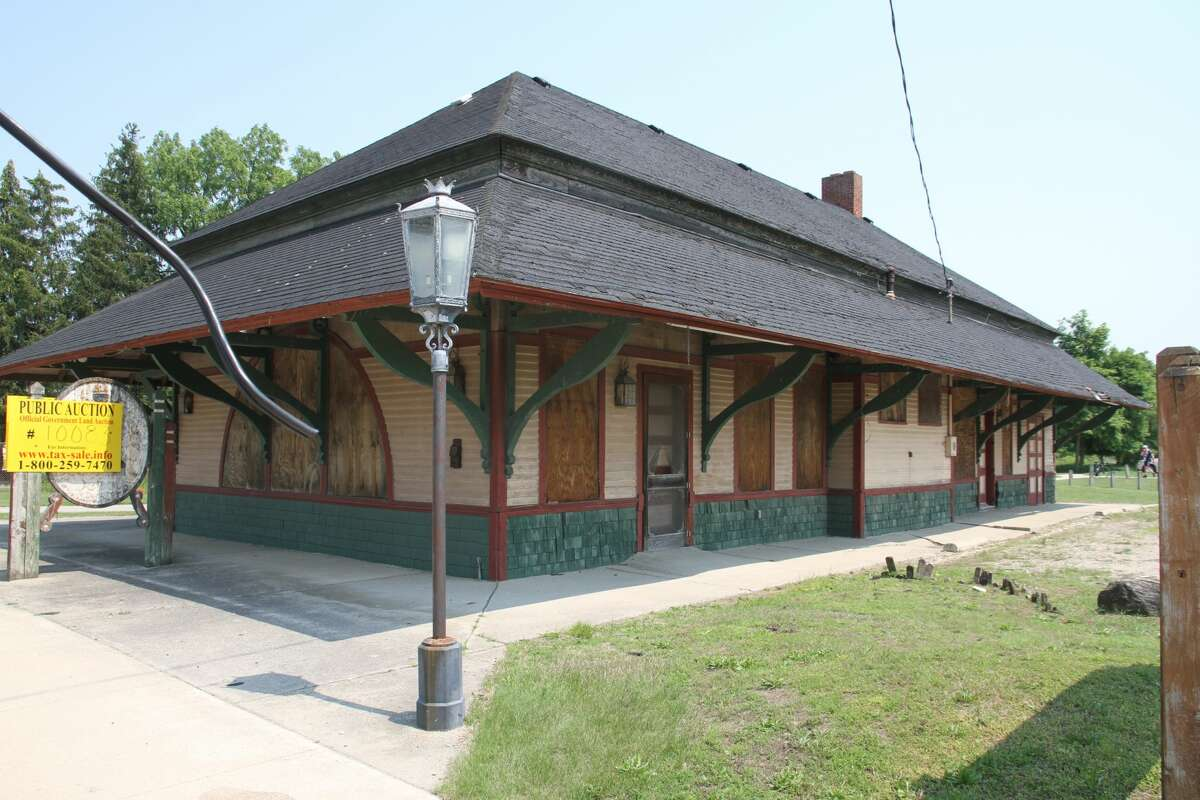 The abandoned Big Rapids Railroad Depot, 0.4-plus acres on Maple Street in Mecosta County (Title-Check Lot 10083).