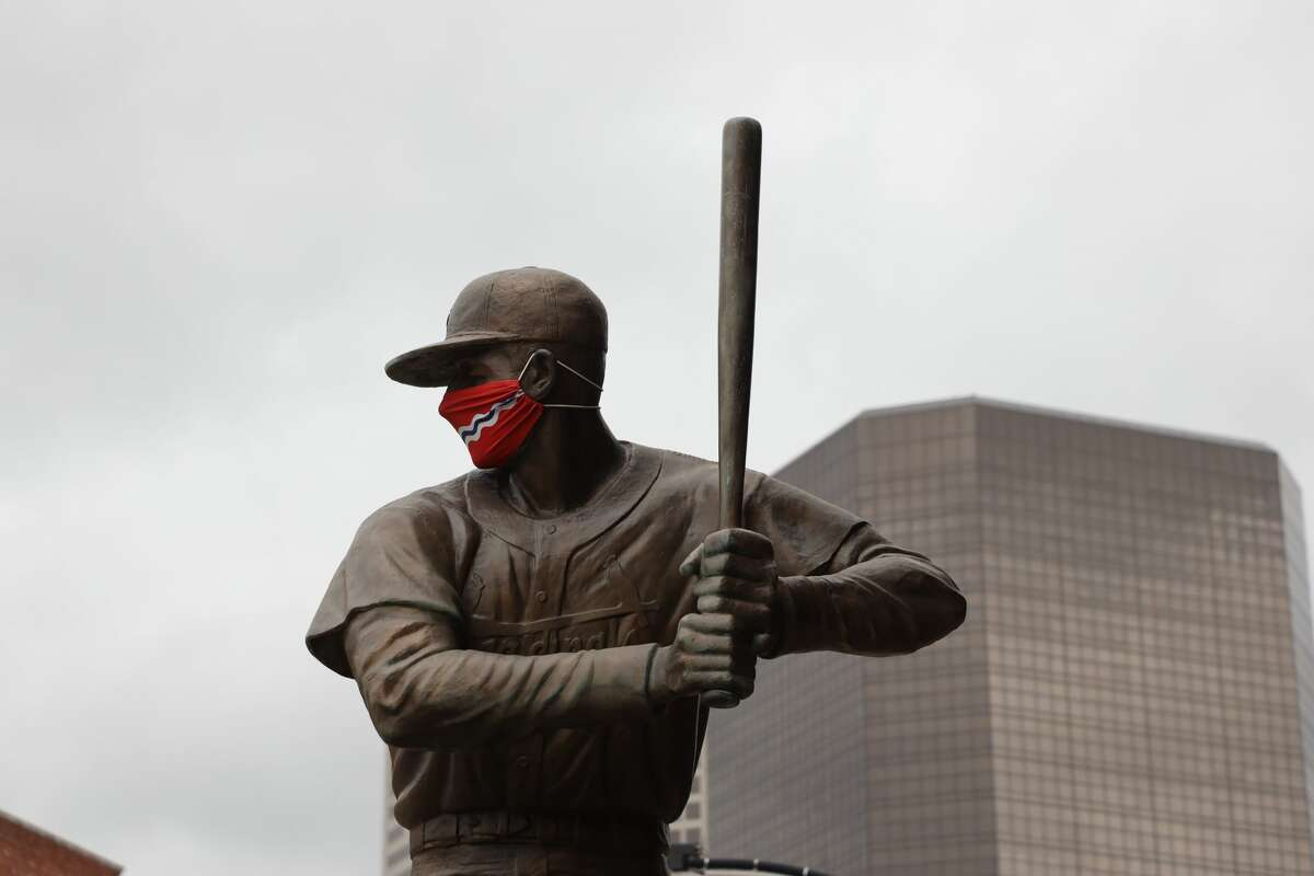 FILE - The Stan Musial statue outside Busch Stadium is decorated in a mask that replicates the St. Louis City Flag on Thursday, April 8, 2021 in St. Louis, Missouri. (Photo by Dilip Vishwanat/MLB Photos via Getty Images)