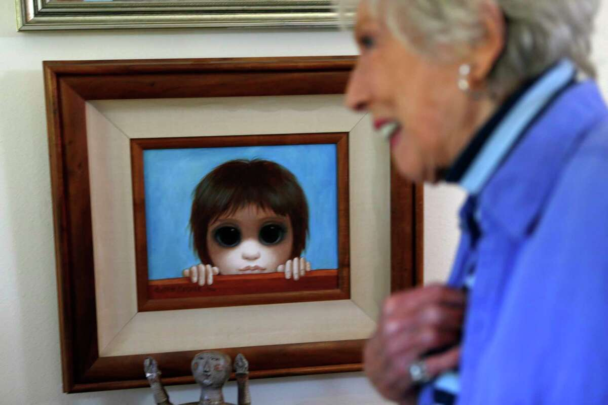 """Painter Margaret Keane, creator of the famous Big Eye paintings of waifs originally credited to her late former husband, Walter, and the subject of Tim Burton's film, """"Big Eyes"""" stands near the painting that she painted in court helping her win her 1986 case against her husband. Photographed at Keane's residence in Napa, Calif., on Tuesday, November 25, 2014."""