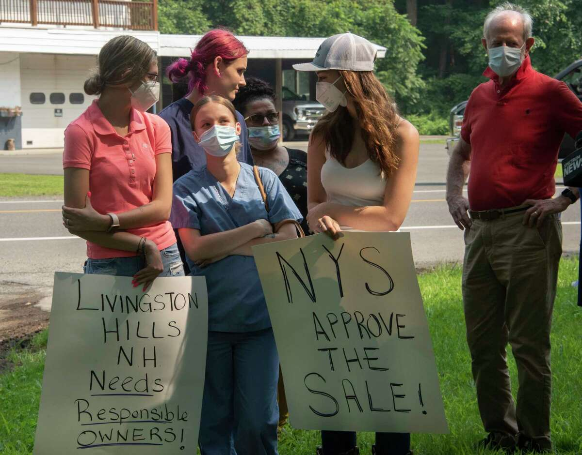 Health care workers talk to each other as 1199SEIU holds a press conference outside Livingston Hills Nursing and Rehab Center to encourage the New York State Department of Health to approve the sale of the nursing facility on Monday, July 26, 2021 in Livingston, N.Y. (Lori Van Buren/Times Union)