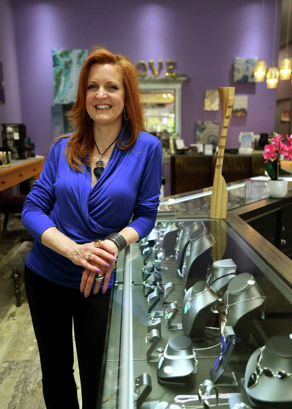 Kathleen McNichols-Marks, owner of Marks of Design, greets customers on Tuesday, May 19, 2020.