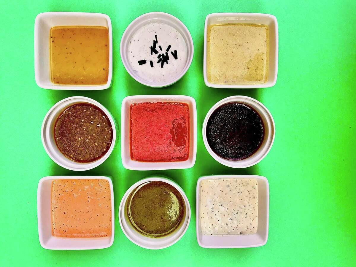 Easy salad dressings and vinaigrettes. Top row, left to right: Honey Mustard Dressing, Classic Ranch Dressing, Foolproof Vinaigrette. Middle row, left to right: Asian Sesame Dressing, Raspberry Vinaigrette, Basil Vinaigrette. Bottom row, left to right: Creamy French Dressing, Honey-Balsamic Vinaigrette, Creamy Italian Dressing.