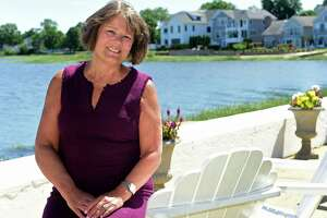 Lisa Brinton, a former mayoral candidate near her home at Shorefront Park Thursday, June 17, 2021, in Norwalk, Conn.