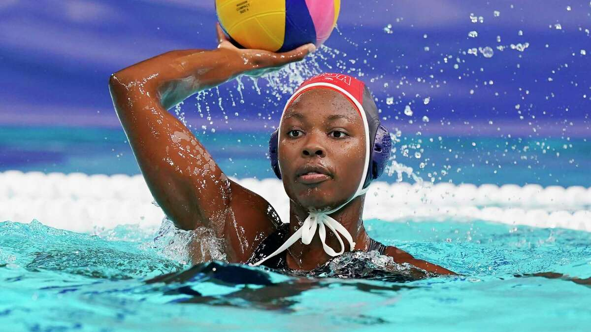 United States' goalkeeper Ashleigh Johnson plays against Japan during a preliminary round women's water polo match at the 2020 Summer Olympics, Saturday, July 24, 2021, in Tokyo, Japan. (AP Photo/Mark Humphrey)