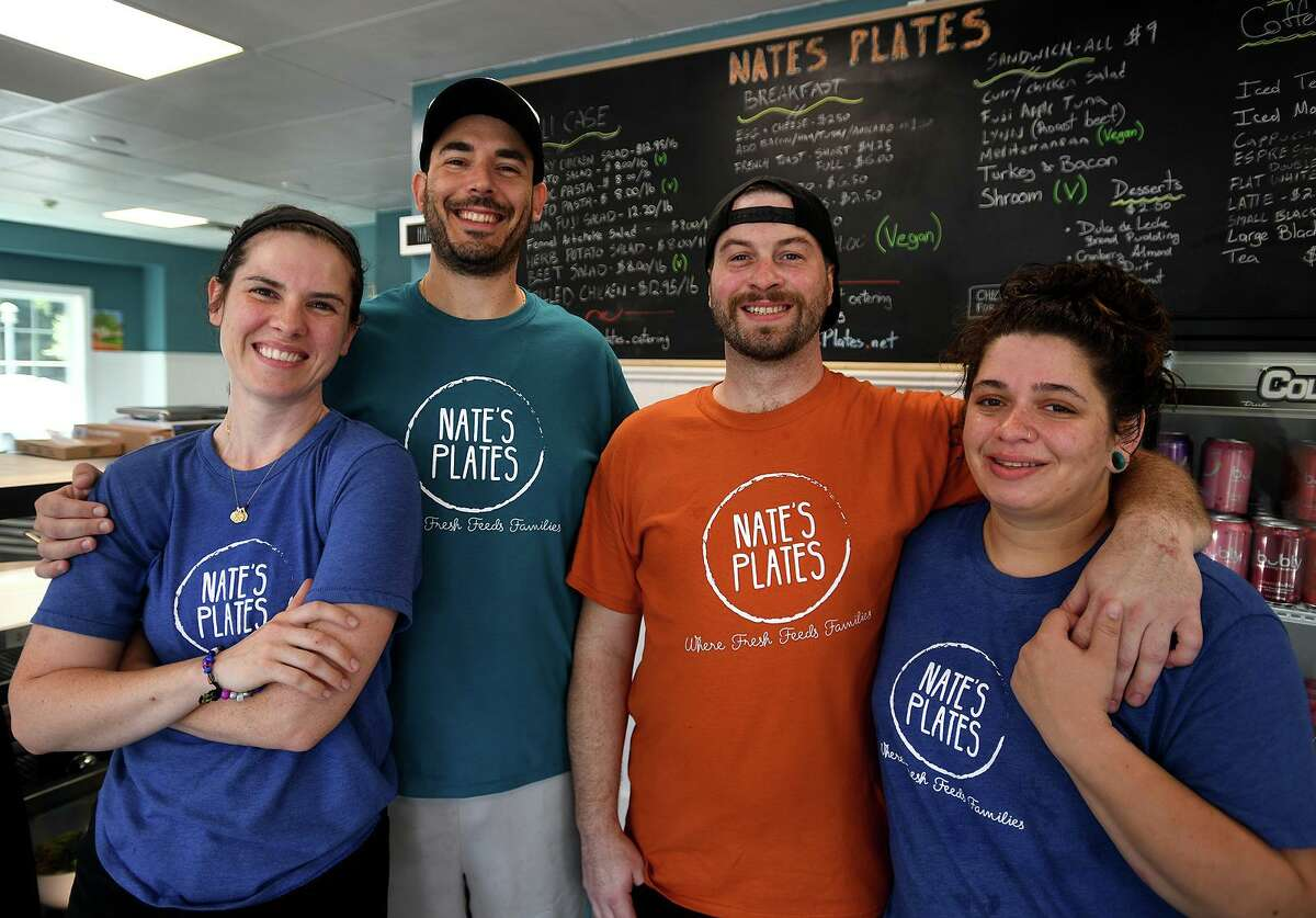 From left; Rachel Lysak, Andres Werthein, Matt McGuinness, and Caitlin Rissman at the new Nate's Plates eatery at 2 Schooner Lane in Milford, Conn. on Monday, July 26, 2021.
