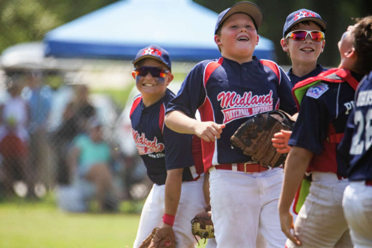 Midland Fraternal Northwest celebrates after a 27-16 victory over Greater Bay in the Little League 11U state tournament Monday, July 26, 2021 at the Bay City Northwest ball complex. (Drew Travis/for the Daily News)