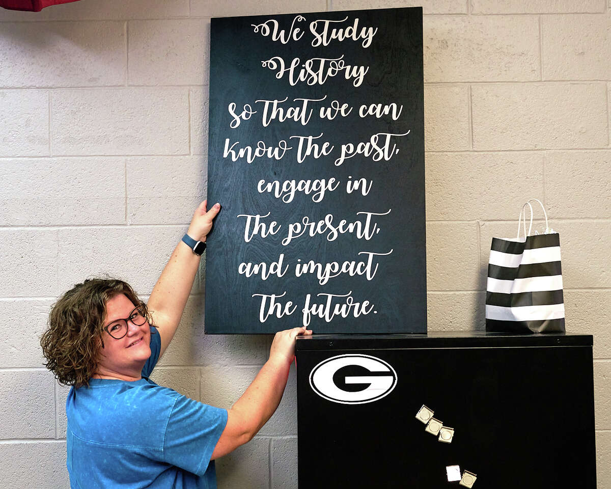 Goddard Junior High U.S. History teacher Amanda Shane hangs an inspirational sign in her classroom Monday, July 26, 2021. Monday was the first day of school for teachers across Midland ISD.