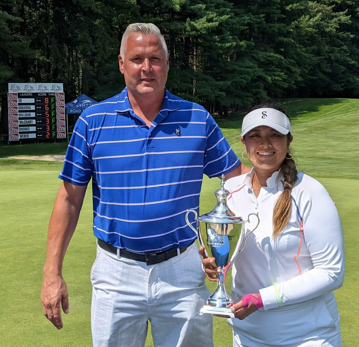 Twin Bridges Championship tournament director Jim Miller presents the trophy to the winner, Lilia Vu of Fountain Valley, Calif., on Sunday, July 25, 2021, at the Pinehaven Country Club in Guilderland. (Pete Dougherty/Times Union)