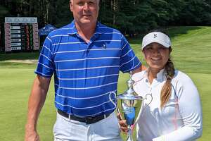 Twin Bridges Championship tournament director Jim Miller presents the trophy to the winner, Lilia Yu of Fountain Valley, Calif., on Sunday, July 25, 2021, at the Pinehaven Country Club in Guilderland. (Pete Dougherty/Times Union)