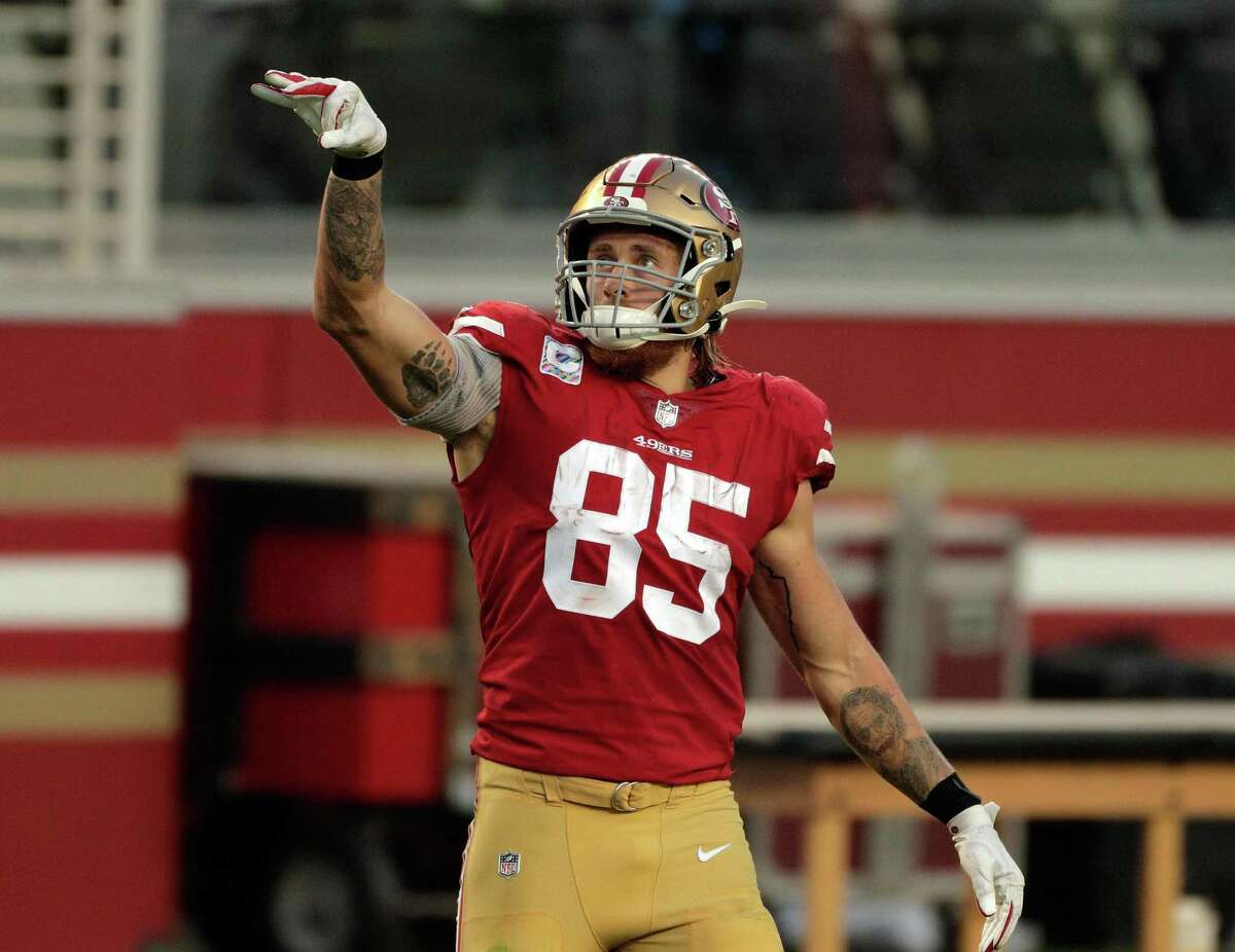 George Kittle (85) gestures for a first down after a 38-yard reception In the first half as the San Francisco 49ers played the Philadelphia Eagles at Levi's Stadium in Santa Clara, Calif., on Sunday, October 4, 2020.