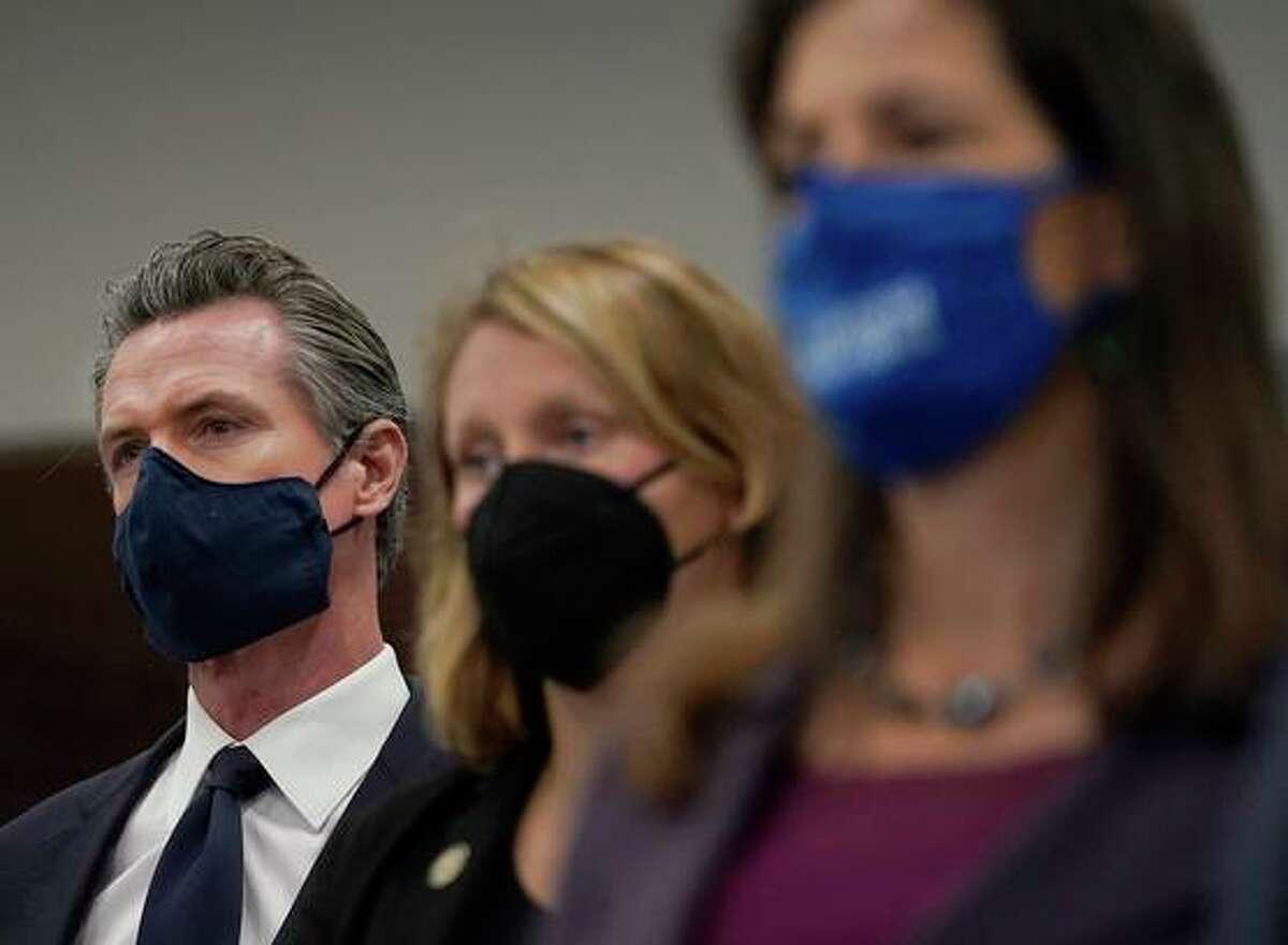 Gov. Gavin Newsom, Assemblywoman Buffy Wicks and Mayor Libby Schaaf in Oakland Monday.