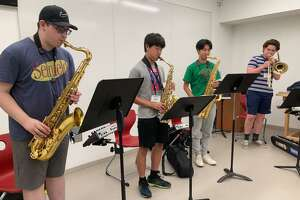 Campers practicing with their instruments