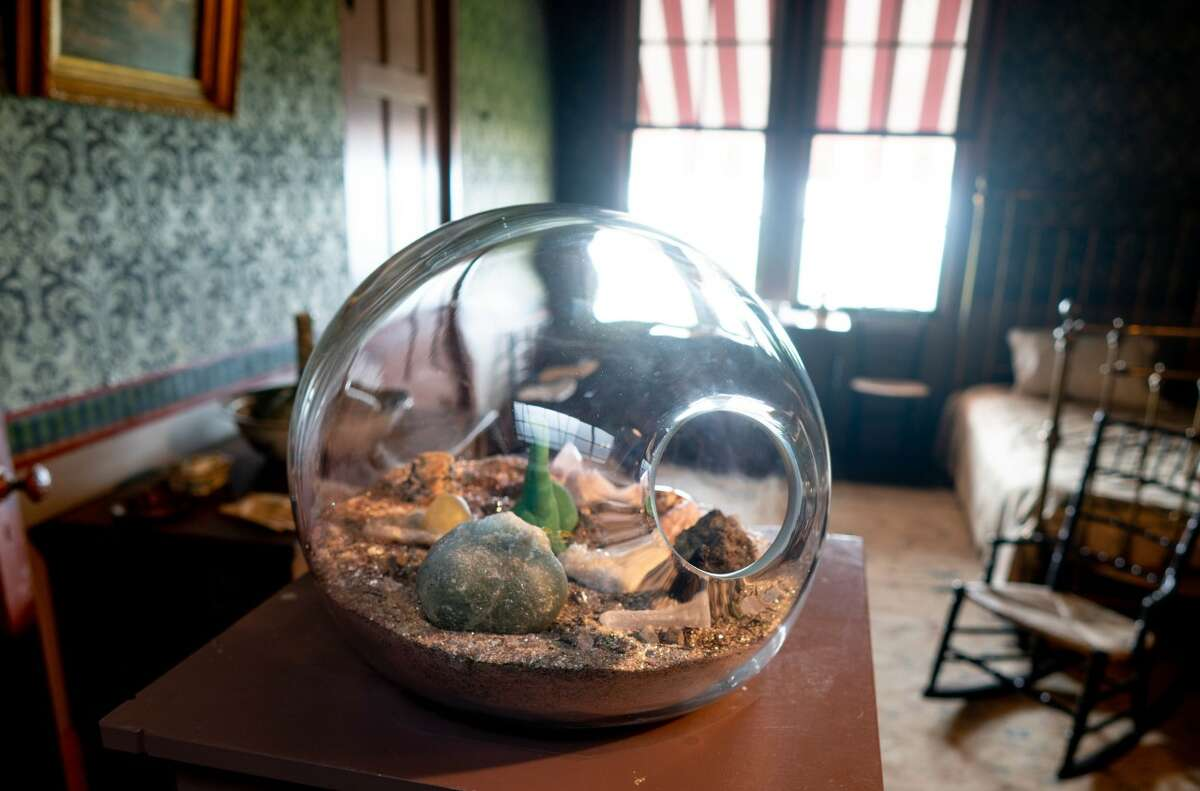 """Paula Hayes, Terrarium MG33, 2010. Hand-blown glass with gems, minerals, substrate of sand, earth pigment, micro glass beads, mica. Olana. As part of """"Cross Pollination: Heade, Cole, Church & Our Contemporary Moment."""" Photo Wm Jaeger"""