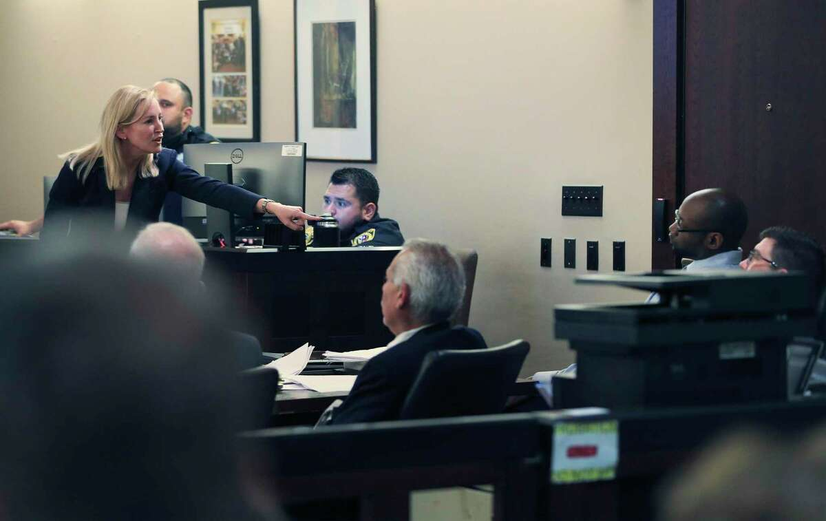 Prosecutor Tamara Strauch points to defendant Otis McKane during closing statements Monday in McKane's capital murder trial for the 2016 shooting of SAPD detective Benjamin Marconi.