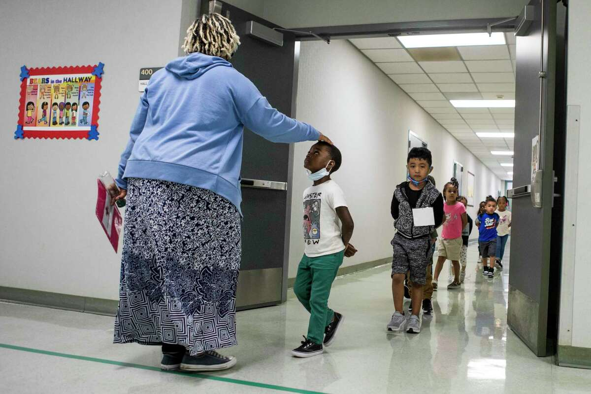 Students at Vines Primary School in Aldine ISD walk to their next class Thursday, July 22, 2021 in Houston. With cases involving COVID variants on the rise, some parents and teachers worry anew about in-person classes this coming school year.