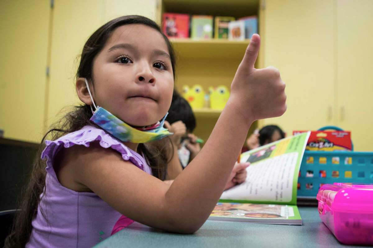 Yoely Aguilar Ortiz gives a thumbs-up showing she is ready in her kindergarten dual language class at Vines Primary School in Aldine ISD Thursday, July 22, 2021 in Houston. Rise in COVID variant cases has some teachers and parents concerned about in-person classes during the upcoming school year.