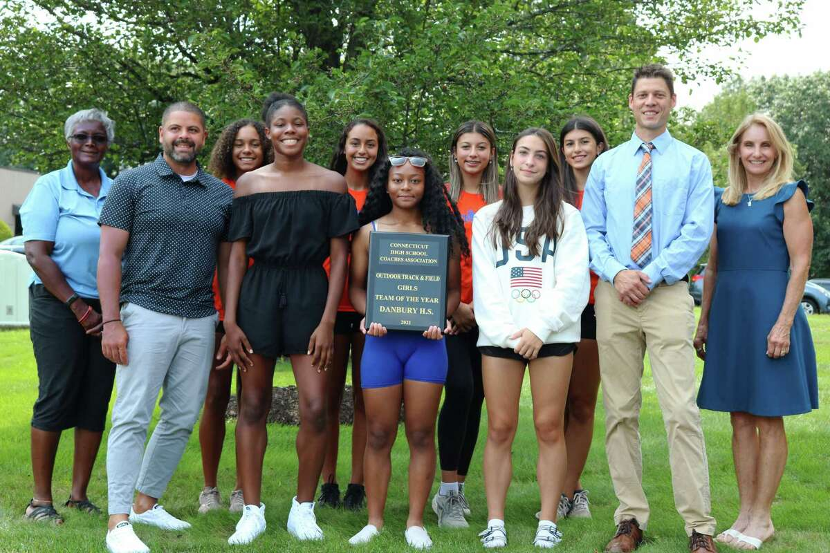 The Danbury girls track team was honored as the state's Team of the Year by the Connecticut High School Coaches Association. From left, CHSCA President Deb Petruzzello, assistant coach Briana Gilliard, Kimberleigh Williams, Corrine Whelchel, Danbury Head Coach Nick Fraticelli, and Barbara Hedden, CHSCA Girls' Outdoor Track & Field Committee Chairperson. Back row from left, Alanna Smith, Stephanie Quieroz, Victoria Batista and Larissa Batista.