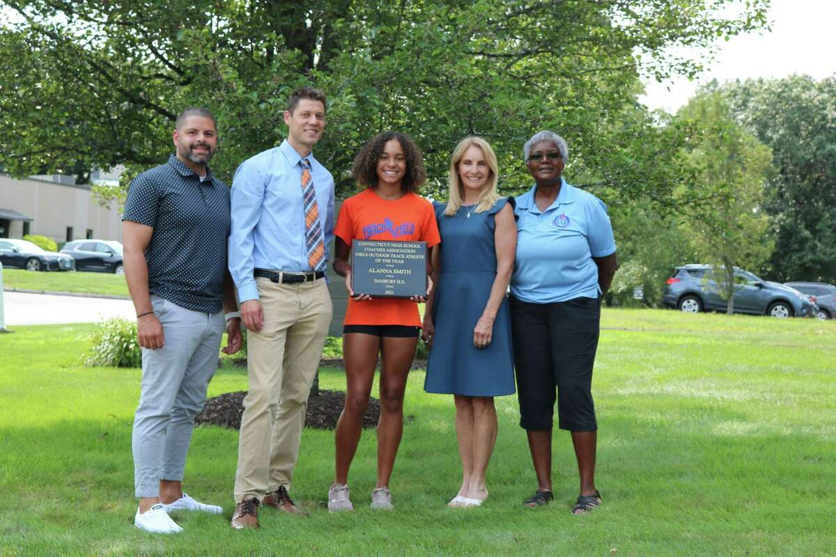From left, Danbury coach, Danbury Head Coach Nick Fraticelli, Alanna Smith, CHSCA Girls Track Athlete of Year, Barbara Hedden - CHSCA Girls' Outdoor Track & Field Committee Chairperson, Deb Petruzzello - CHSCA President.