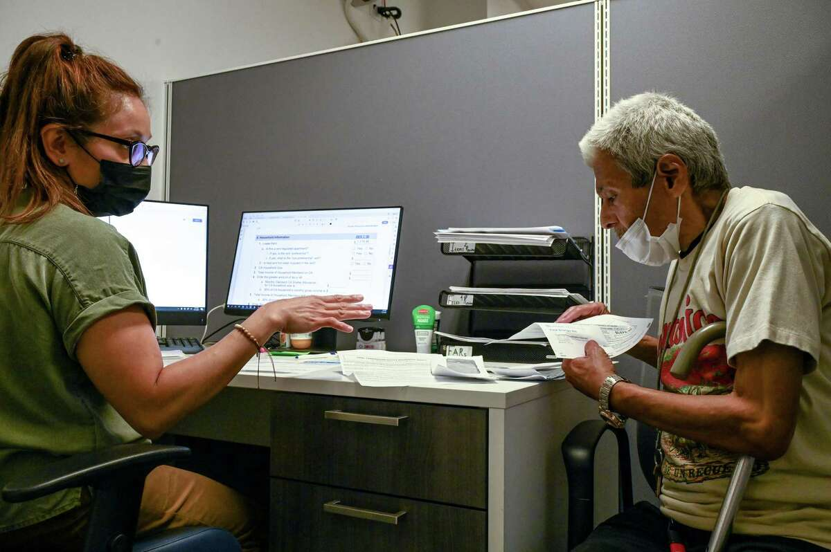 Jordana Gonzalez, left, a coordinator at BronxWorks, helps Miguel Moran, 68, apply for the state's emergency rental assistance program, which was designed to aid people who have fallen behind on rent, at the company's offices in New York, July 21, 2021. The program, designed to prevent mass evictions, has gotten off to a slow start, advocates said - and the end of the state's eviction moratorium looms.