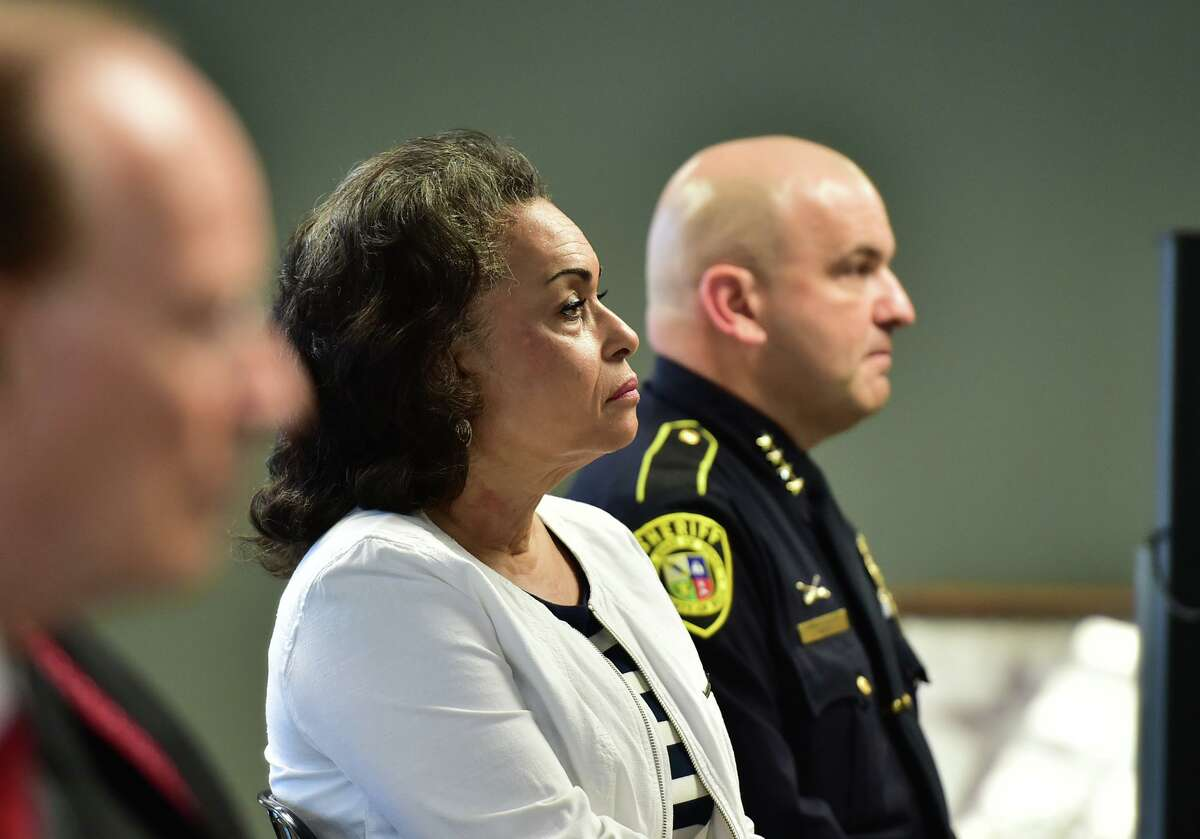 Jelynne LeBlanc Jamison, president and CEO of the Center for Heath Care Services, and Bexar County Sheriff Javier Salazar listen at a news conference highlighting the expansion of the Specialized Multidisciplinary Alternate Response Team, or SMART, Monday morning.