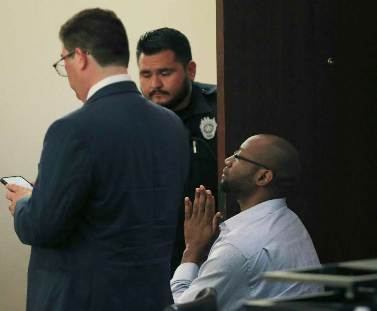 McKane clasps his hands together right before he appeared to assault the courtroom bailiffs after the jury delivered a guilty verdict in his capital murder trial Monday.
