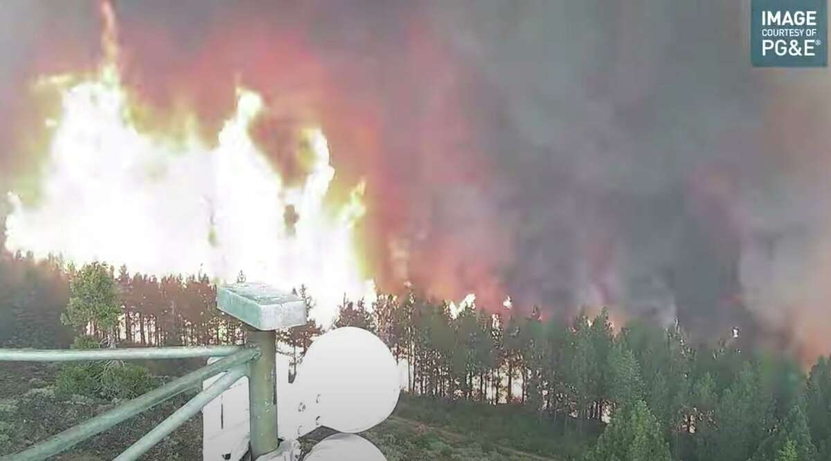 In this video frame grab, the remote wildfire camera at Indian Ridge in the Sierra near Lake Almanor captures flames from the Dixie Fire that will soon engulf it on Saturday, July 24, 2021.