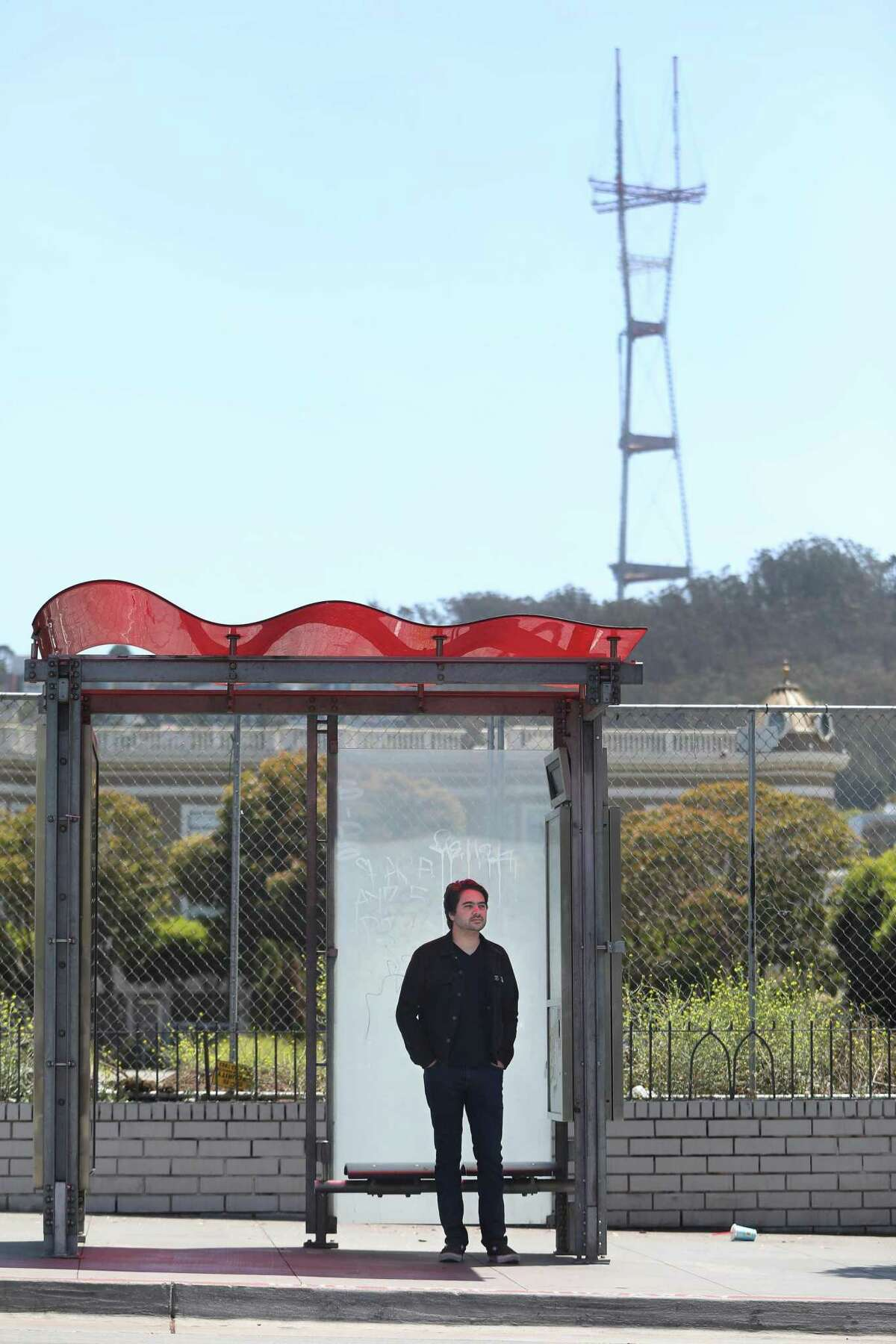 Chris Arvin waits for the 33 Ashbury Muni bus at the corner of Haight and Stanyan Streets in San Francisco.