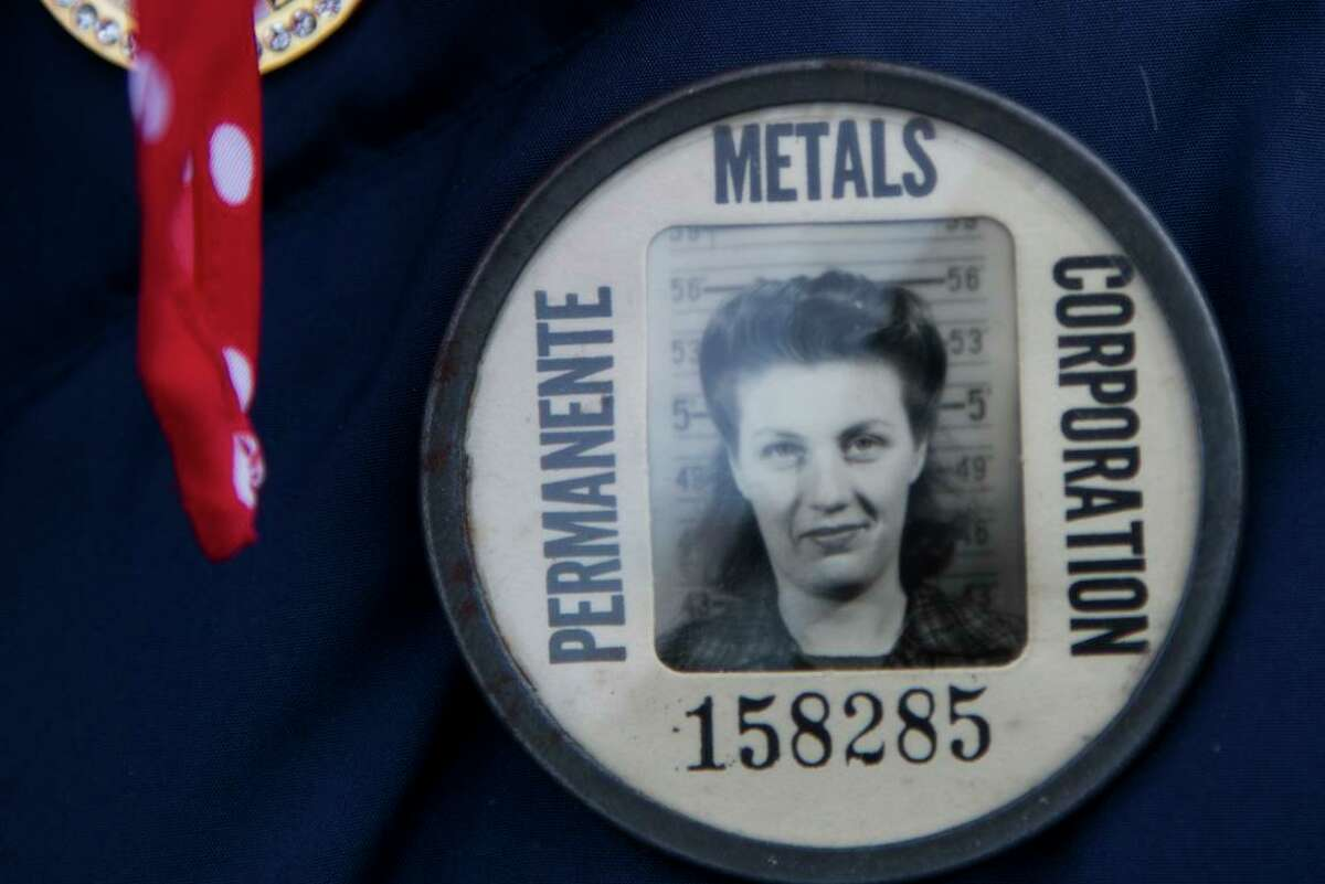 Phyllis Gould wears the identification button she used when she was working as a welder at Kaiser Shipyard in Richmond during World War II as she and other Rosie the Riveters visited the White House in 2014.