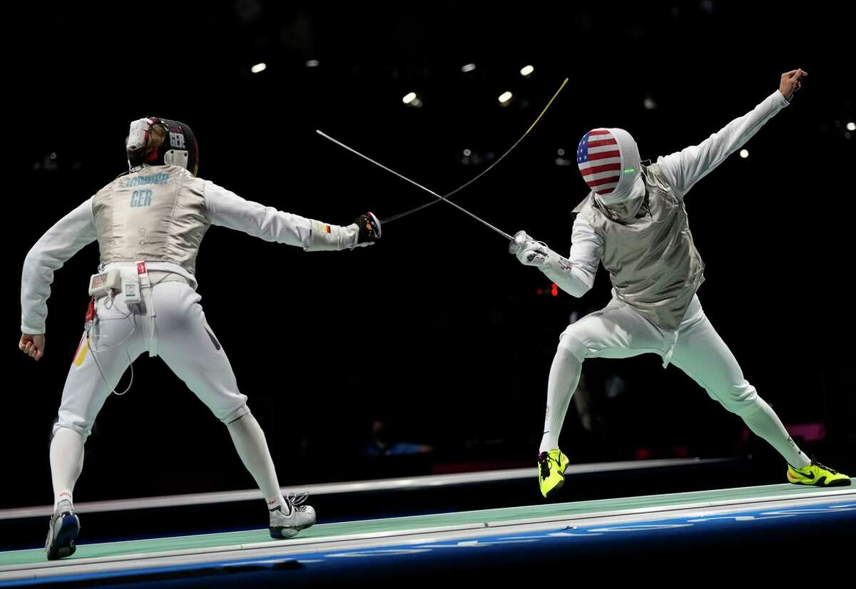 Alexander Massialas of the United States, right, and Peter Joppich of Germany compete in the men's individual round of 32 Foil competition at the 2020 Summer Olympics, Monday, July 26, 2021, in Chiba, Japan. (AP Photo/Hassan Ammar)
