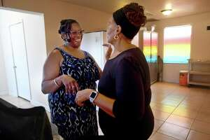 Doris Bishop (right) greets Stacy Smith as she arrrives to pick up meals for her grandchildren during the Summer Meals program at St. Luke Missionary Baptist Church Monday.  Photo made Monday, July 26, 2021 Kim Brent/The Enterprise