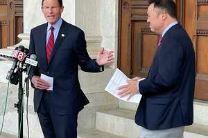 Sen. Richard Blumenthal, D-Connecticut, and Connecticut Attorney General William Tong speak Monday, July 26, 2021 outside the state Capitol in Hartford, in support of legislation that would prohibit legal protections that the owners of OxyContin maker Purdue Pharma are seeking to gain in bankruptcy court.