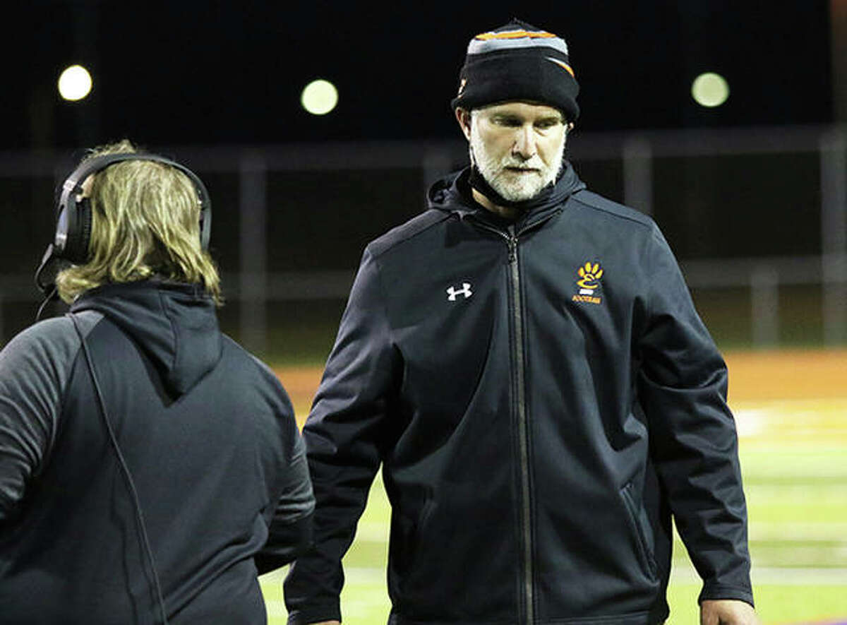 Edwardsville coach Matt Martin (right) walks the sideline during the Tigers' Southwestern Conference championship game April 23 at East St. Louis. Martin is the 2021 Telegraph Large-Schools Football Coach of the Year.