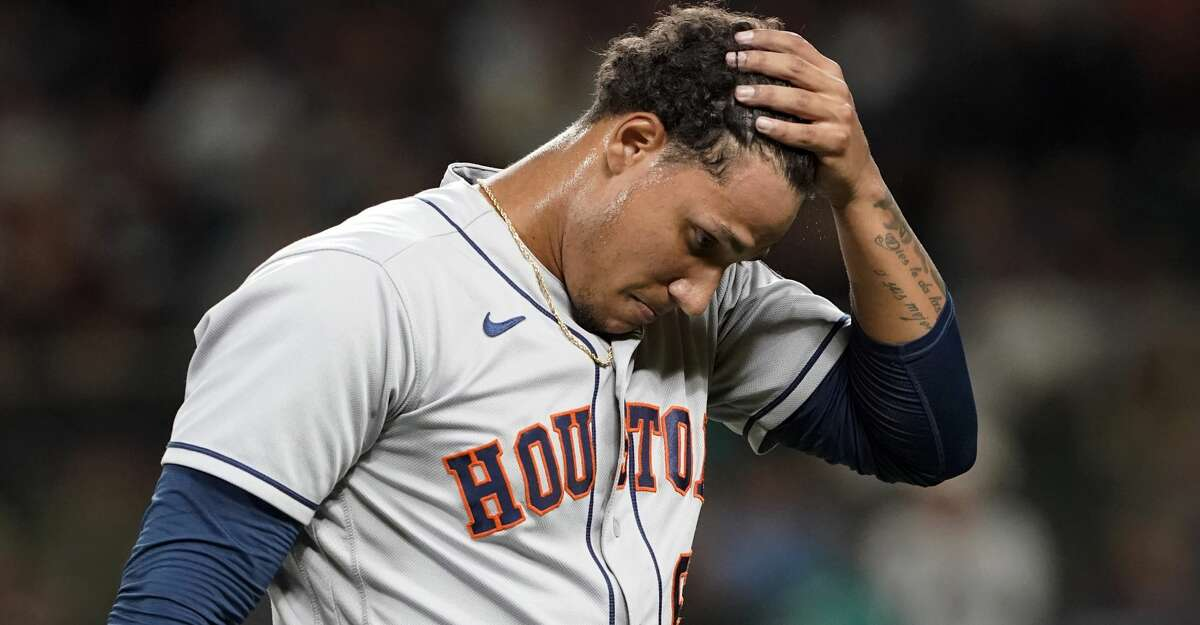 Houston Astros pitcher Bryan Abreu walks off the field after being pulled during the sixth inning of a baseball game against the Seattle Mariners, Monday, July 26, 2021, in Seattle. (AP Photo/Ted S. Warren)