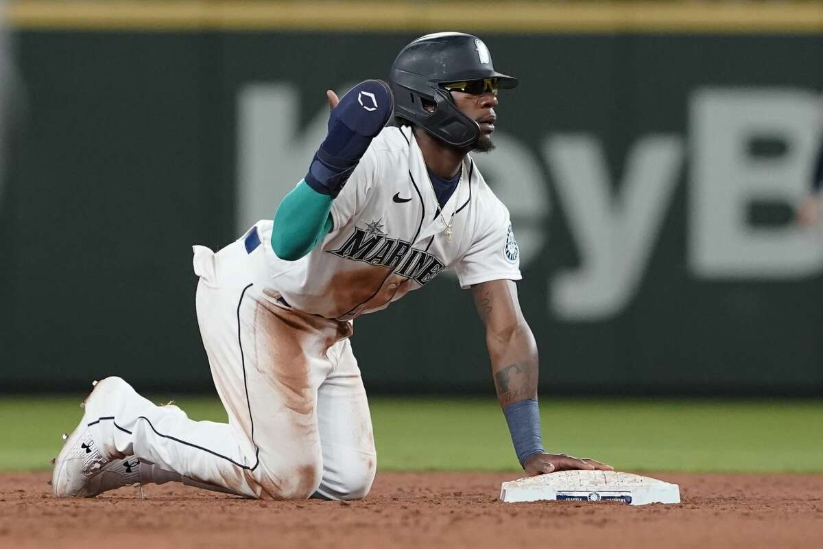 Seattle Mariners' Shed Long Jr. reacts after he tried to steal second base during the sixth inning of a baseball game against the Houston Astros, Monday, July 26, 2021, in Seattle, but Mariners' Dylan Moore struck out to end the inning on the play. (AP Photo/Ted S. Warren)