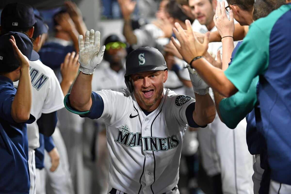 SEATTLE, WASHINGTON - JULY 26: Kyle Seager #15 of the Seattle Mariners celebrates with teammates after hitting a three run home run in the fifth inning of the game against the Houston Astros at T-Mobile Park on July 26, 2021 in Seattle, Washington. (Photo by Alika Jenner/Getty Images)