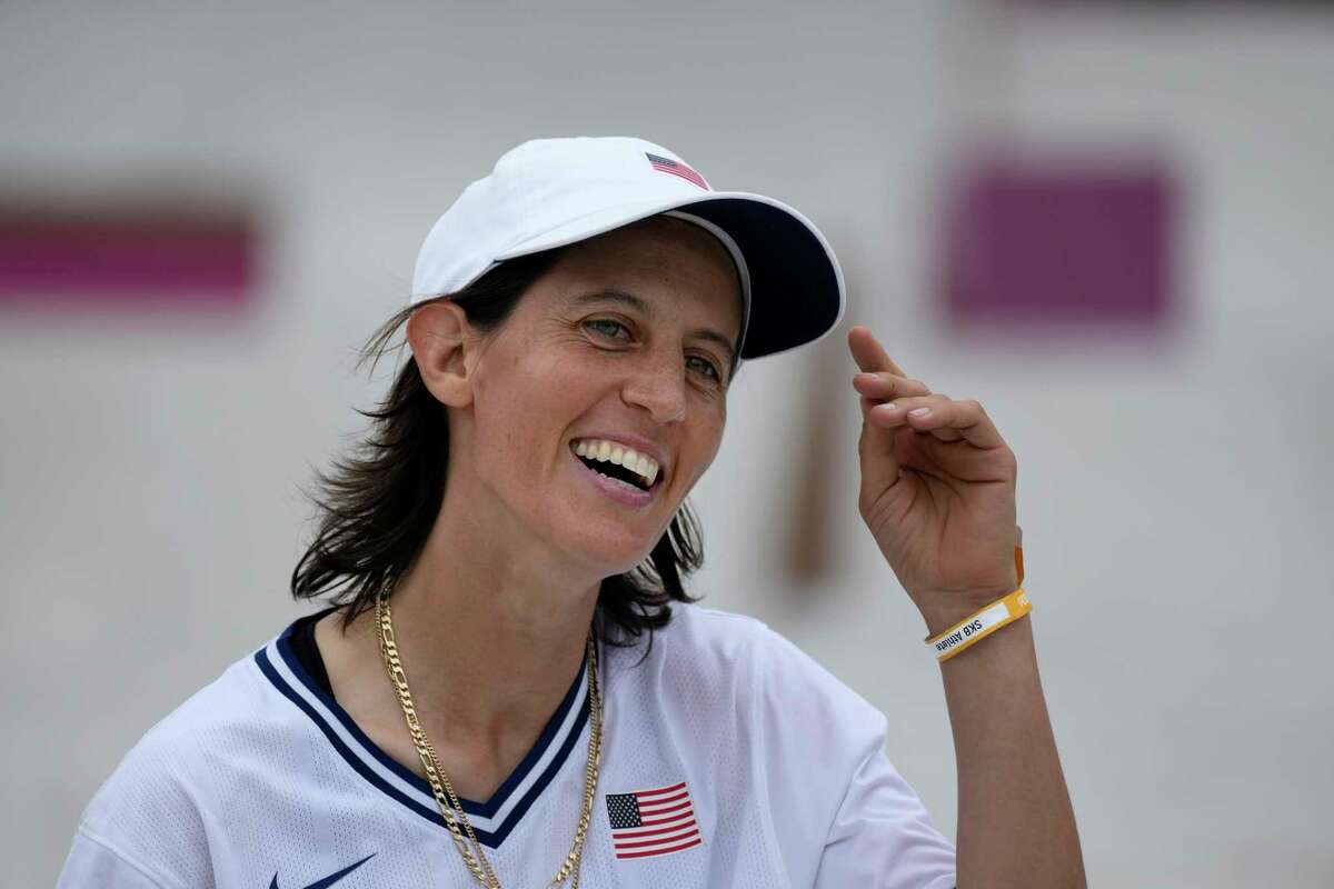 """FILE - In this July 26, 2021, file photo, Alexis Sablone of the United States smiles during the women's street skateboarding finals at the 2020 Summer Olympics in Tokyo, Japan. The Tokyo Games are shaping up as a watershed for LGBTQ Olympians. Openly gay Sablone says """"it's about time."""""""