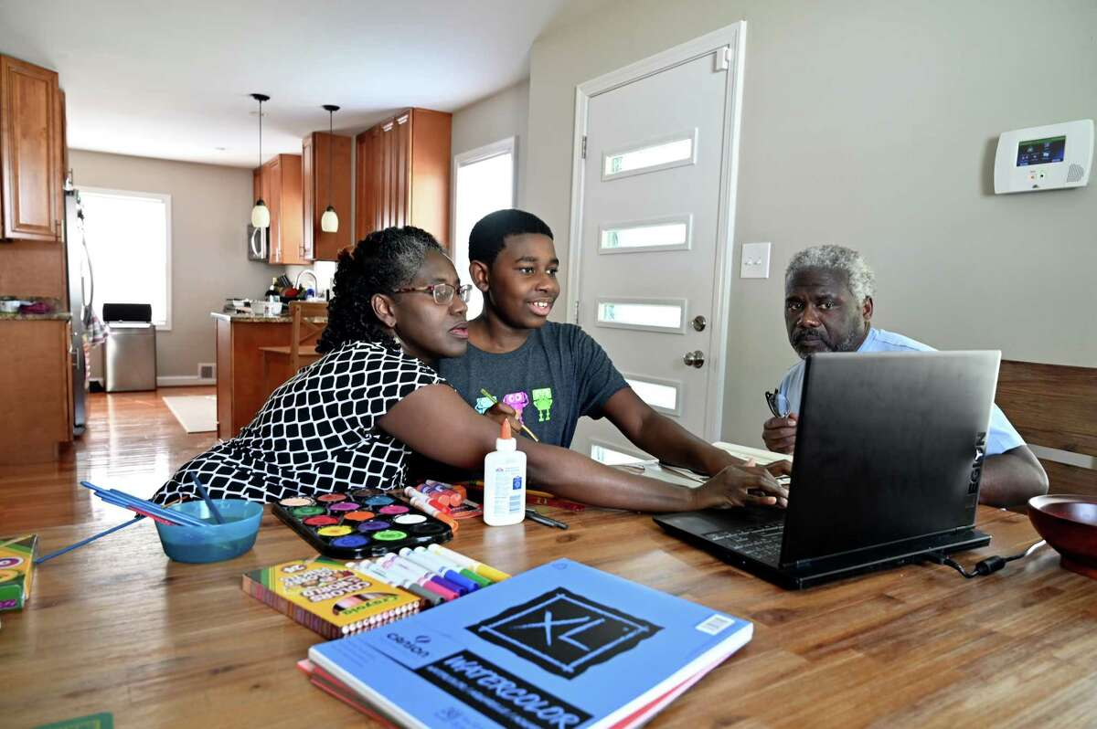 yce Yorke, 11 with his parents Shenan Yorke (father) and Tracie Yorke (mother) in their home in Hyattsville, Md., on June 30, 2021.