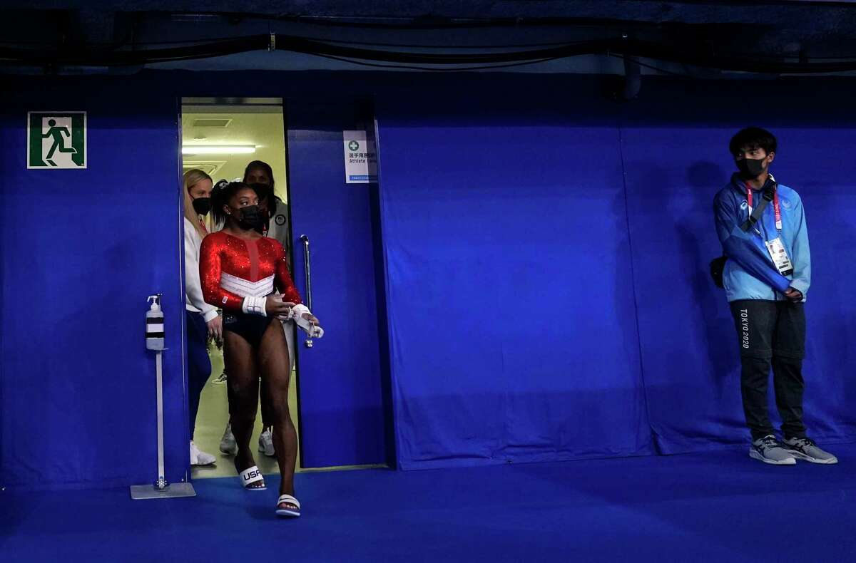 Simone Biles, of the United States, enters the court for the artistic gymnastics women's final at the 2020 Summer Olympics, Tuesday, July 27, 2021, in Tokyo.