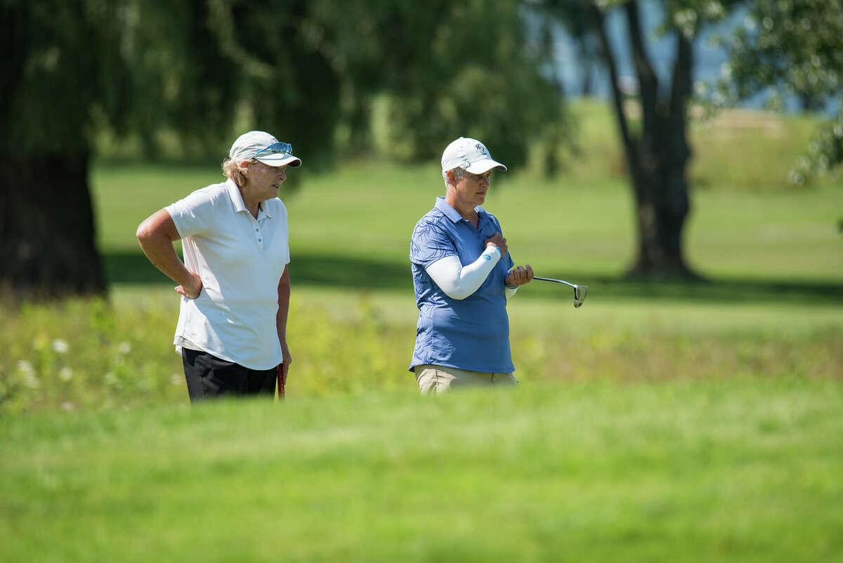 Karen Feldman, left, of Olde Kinderhook and Patricia Mayne of Western Turnpike discuss strategy during the 2021 NYS Women's Senior Amateur Four-Ball Championship on July 23, 2021, at Lakeshore Yacht & Country Club in Cicero. (Dan Thompson/NYSGA)