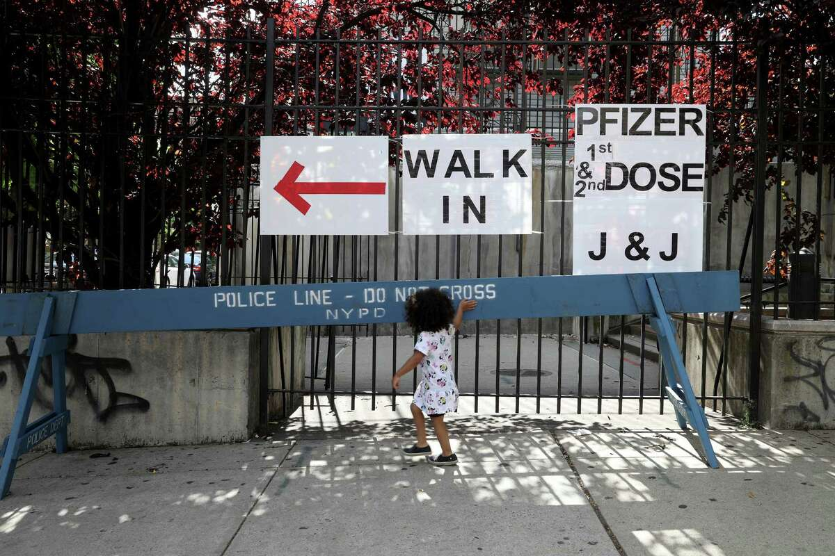 A child outside a vaccination site at Medgar Evers College in Brooklyn on June 23, 2021. California and New York City announced that they would require hundreds of thousands of government workers to get inoculations or face weekly testing.