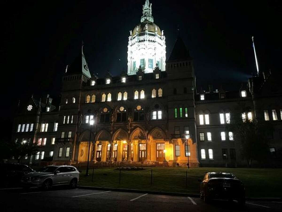 The state Capitol was lit up the night of June 8, 2021 as the House of Representatives debated the two-year budget bill. The $46.4 biennial budget contained a $2.3 billion surplus which has now grown by about $500 million.