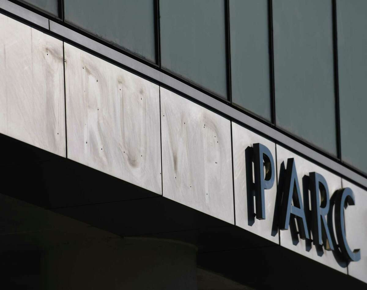 """The """"Trump"""" lettering is taken off of the Trump Parc apartment building in Stamford, Conn. Tuesday, Feb. 16, 2021."""