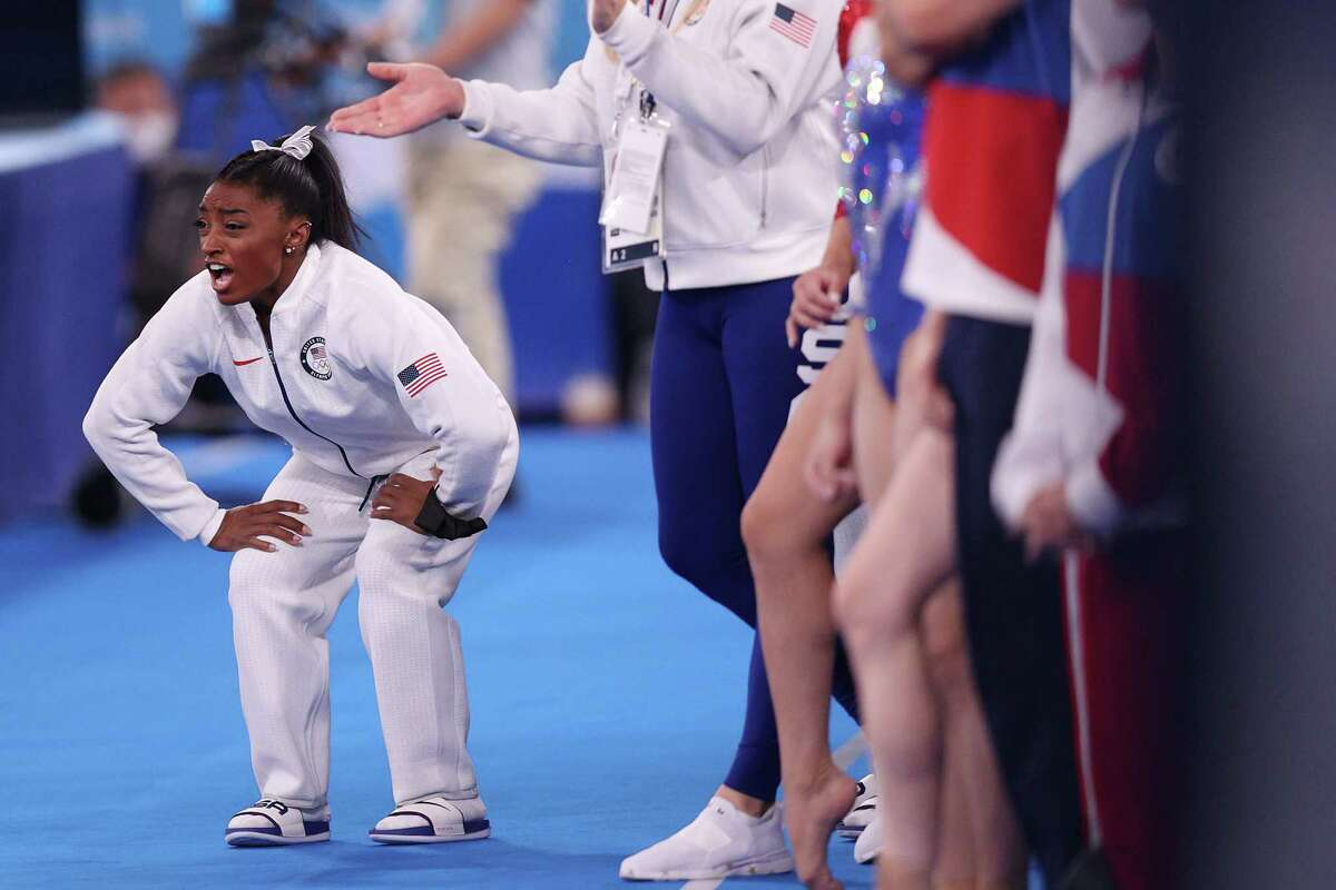imone Biles of Team United States cheers during the Women's Team Final on day four of the Tokyo 2020 Olympic Games at Ariake Gymnastics Centre on July 27, 2021 in Tokyo, Japan.