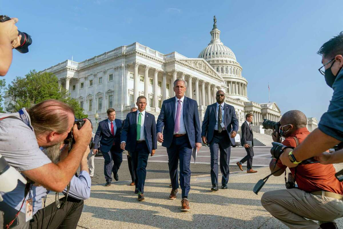 House Minority Leader Kevin McCarthy of Calif., accompanied by Rep. Kelly Armstrong, R-N.D., second from left, and other Republican House members, walk out to hold a news conference as the select committee on the Jan. 6 attack appointed by House Speaker Nancy Pelosi will begin to hold its first hearing, on Capitol Hill in Washington, Tuesday, July 27, 2021.