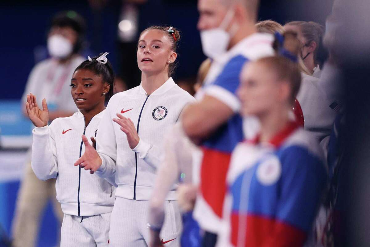 TOKYO, JAPAN - JULY 27: Simone Biles and Grace McCallum of Team United States cheer as Jordan Chiles (not pictured) competes in floor routine during the Women's Team Final on day four of the Tokyo 2020 Olympic Games at Ariake Gymnastics Centre on July 27, 2021 in Tokyo, Japan.