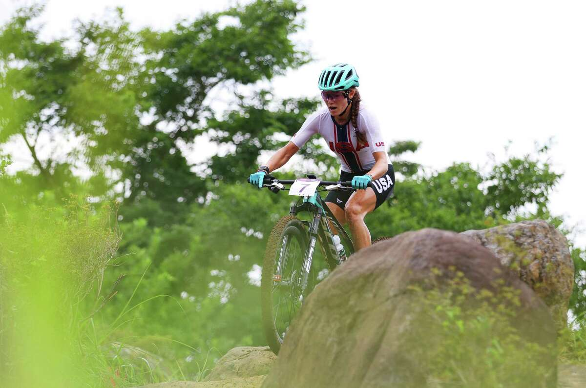 IZU, JAPAN - JULY 27: Kate Courtney of Team United States rides during the Women's Cross-country race on day four of the Tokyo 2020 Olympic Games at Izu Mountain Bike Course on July 27, 2021 in Izu, Shizuoka, Japan. (Photo by Tim de Waele/Getty Images)
